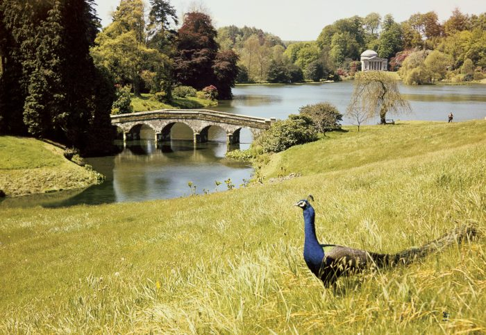 Stourhead, Wiltshire: view of the Pantheon across the lake with the turf bridge, photograph by Edwin Smith. Edwin Smith / RIBA Library Photographs Collection